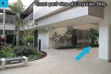 Through the court yard or Atrium, with Satellite City Hall on your right, walk pass the gate.